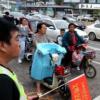 大观楼城管大队在城区主要路口开展人守规文明交通劝导实践活动